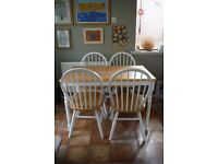 White shabby chic/ country style, wooden topped table and 4 chairs.