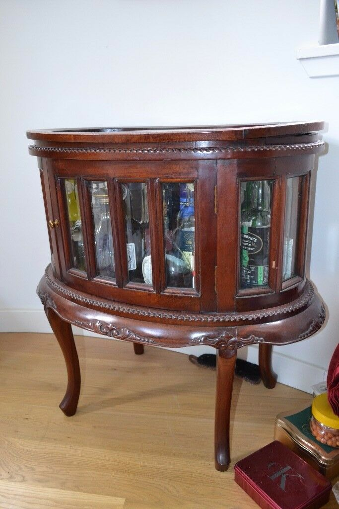 Oval drinks cabinet with removable tray in meadows for Affordable furniture pretoria