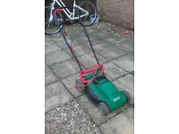Lawn mower ( comes with box that collects grass)