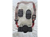 Canon AV1 35mm SLR camera with zoom lens, flash and camera case