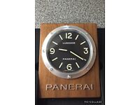 Paneria luminor dealer wall clock brand new in box mounted on teak wood. It's like Rolex or omega