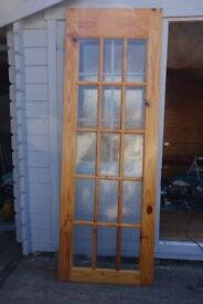 A pair of beautiful pine and textured glass interior doors