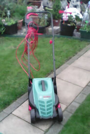New boxed Rotak 32-12 lawnmower