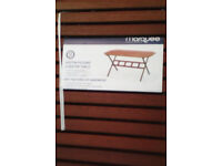 Austin 6 seater solid wood octaganal table ( new boxed )