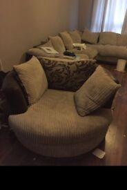 Brown swivel chair with reversable cushions