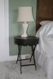 bed-side tables with bed-side lamps
