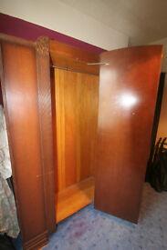 Large dark wood wardrobe