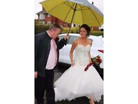 Ivory bestoke wedding dress, custom made. Size 10. Can be altereted smaller or slightly larger.