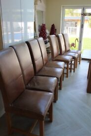 7 x Leather dining table chairs