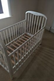 white metal baby cot with mattress