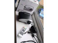 Mini LED Projector HD Contrast Ratio 500:1 with HDMI/SD/USB/Audio/VGA/AV