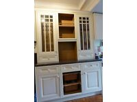 Kitchen dresser unit with glass doors and work top