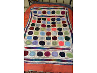 Knitted throw, made by knitting group. 64 by 46 inch. Single bed or settee.