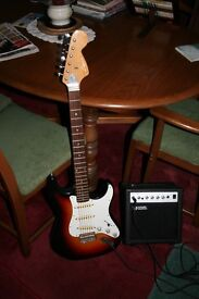 Sumbro electric guitar+brand new amplifier.Would make a lovely Christmas present