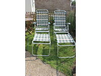 2 reclining chairs with 2 matching footstools/tables