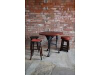 Cast iron table and stools. Man cave