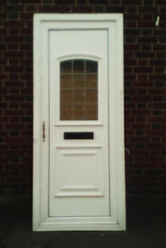 white upvc door with obscure and leaded panel to the top