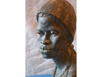 Sculpture in variegated grey/beige Soap Stone of African female