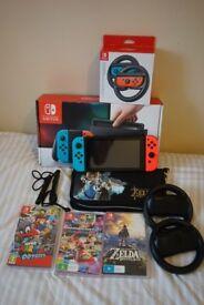 Nintendo Switch Bundle + 3 games + 2 joycon wheels + case *brand new*