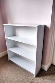 White bookcase or shelving. 90cm high, 28cm wide and 25cm deep.