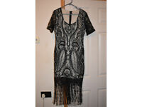 Black Lace womans dress with tassels.