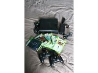 xbox 360 4gb with two controllers and 6 games