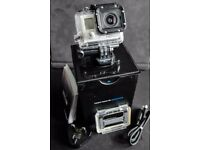 GoPro Hero 3 action camera with 4Gb memory card. Boxed with charger & mounts