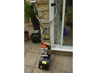 Stihl MM55 Multi Garden Tool with lawn care and rotovator attachments