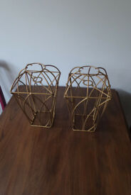 A pair of metal lampshades