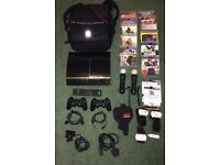 Early Playstation 3 CECHA12 Console. 60GB backwards compatible, loads of extras.