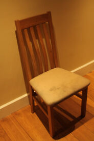 Four second-hand oak dining chairs with fabric seat pads