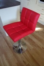 Starz Bar Stool in red leather with brushed steel base, footrest and gas lift