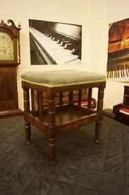 Antique mahogany piano stool with music shelf