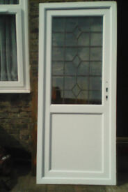 White upvc door with lovely leaded detail in the panel,