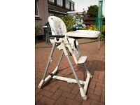 High Chair Prima Pappa. Upright and reclines, with table. Used but good condition.