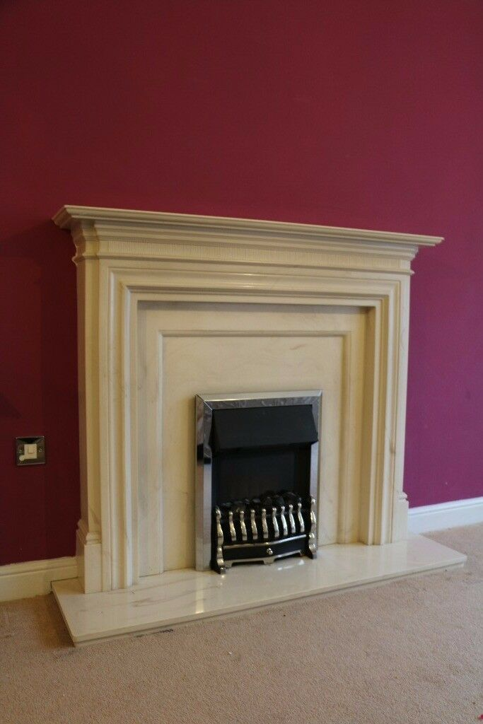 Cream fireplace, marble-type hearth and chrome electric fire