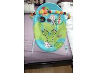 Bright Starts rocking vibrating baby bouncer. Perfect condition.