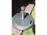 Parasol base, very heavy, concrete filled, handle and wheels, unused