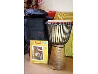 Djembe hand drum with bag and book.
