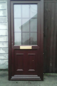 Upvc door for sale it is Rosewood on the outside, and white inside,.