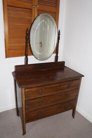 Dressing table with a mirror on wheels in good condition.