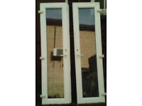 White upvc french doors, with clear full length glazing,.