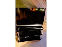 Sony Bravia TV + remote + glass stand