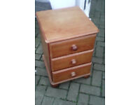 Very well made solid pine three draw bedside cabinet,.