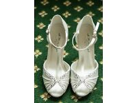 Ivory Bridal open toesd shoes with light beading and ankle straps.