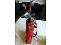 Set of golf irons with red bag - in good condition