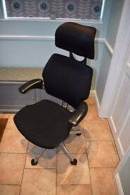 Humanscale Freedom Chair in black including headrest and chrome hardware