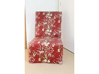 Bedroom upholstered chair .Comes with loose cover
