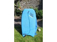 body board. surfing shoes size 9 and a paddle