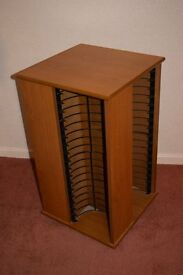 Revolving storage cabinet in teak wood.